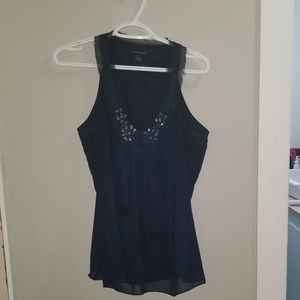 navy blue blouse with beaded accents.